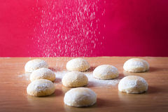 Kahk El Eid with sugar. Pouring sugar on Kahk El Eid - Feast Cookies Royalty Free Stock Photography