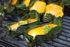 Kai Pam, Egg mixed with vegetable and grill on banana leaf. Egg mixed with vegetable and grill on banana leaf , Thailand Northern Food, Kai Pam Stock Photo