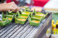 Kai-Pam or Grilled egg on banana leaf cup Thailand. Royalty Free Stock Photography