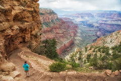 Kaibab trail, south rim, Grand Canyon. Young girl in blue on Kaibab trail into canyon Stock Image