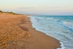 Kaiafas beach, Greece. Landscape of sandy Kaifas beach at sunset, Greece stock photo