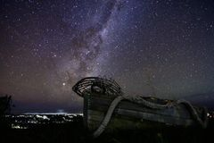 Kaikoura Milky way. Kaikoura coastline with beautiful milky way in the background with a old boat stock photos