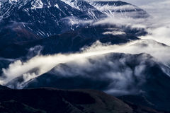 Kaikoura Mountain range. Low cloud over the Kaikoura ranges, Mt Fyffe early winter, a popular Mountain to climb and ski tour on, look for more New Zealand images Royalty Free Stock Photos