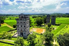 Kaiping Diaolou scenic area china. The historic buildings and a rice paddy at Kaiping Diaolou in Zili village in Kaiping China in Guangdong province on a sunny stock photos