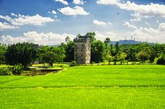 Kaiping Diaolou Village building and rice paddy. The historic buildings of Kaiping Diaolou in Zili village in Kaiping China in Guangdong province on a sunny blue royalty free stock photography