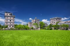Kaiping Diaolou Village buildings and rice paddy. The historic buildings of Kaiping Diaolou in Zili village in Kaiping China in Guangdong province on a sunny stock photos