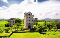 Kaiping Diaoluo Village buildings China. The historic buildings and a rice paddy at Kaiping Diaolou in Zili village in Kaiping China in Guangdong province on a stock photography