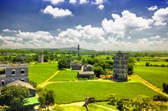 Kaiping tower Diaolou village buildings. The historic buildings of Kaiping Diaolou in Zili village in Kaiping China in Guangdong province on a sunny blue sky day stock image