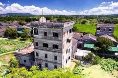 Kaiping tower Diaolou village buildings. The historic buildings of Kaiping Diaolou in Zili village in Kaiping China in Guangdong province on a sunny blue sky day stock photography