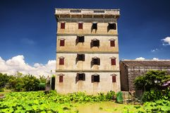 Kaiping tower Diaolou village buildings. A lotus pond behind a tower building at Kaiping Diaolou historic building in Guangdong province China royalty free stock photos
