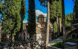 The Kaisariani Monastery an Eastern Orthodox holy place built on the north side of Mount Hymettus, near Athens, Greece stock photography