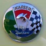 Kaiser Darrin Chrome Badge. Kaiser Darrin 161 Chrome Badge over light green Royalty Free Stock Photos