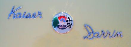 Kaiser Darrin Chrome Badge and Script. Kaiser Darrin 161 Chrome Badge and Script over light green Royalty Free Stock Photo