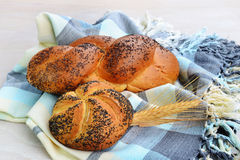 Kaiser roll and Mohnflesserl braided bun sprinkled with poppy seed Stock Image