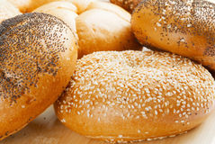 Kaiser Rolls. Close-up of assorted Kaiser rolls. Some are topped with sesame seeds, some with poppy seeds and a few plain. Shallow DOF Royalty Free Stock Photos