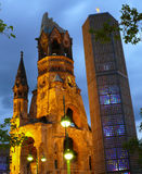 Kaiser William Memorial Church. Low angle view of Kaiser William Memorial Church illuminated at night with modern belfry in foreground, Berlin, Germany Royalty Free Stock Images