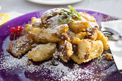 Kaiserschmarren served on purple plate Stock Images