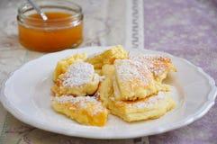 Kaiserschmarrn. Austrian sweet dessert called kaiserschmarrn with apple sauce Royalty Free Stock Images