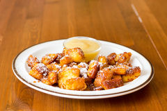 Kaiserschmarrn (traditional Austrian pancake) with sugar powder and applesauce. Portion of fresh Kaiserschmarrn with sugar powder and applesauce. Dessert ( Stock Images