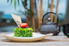 Kaiso salad on a plate with peanut sauce Royalty Free Stock Photo