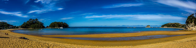 Kaiteriteri Beach Panarama. The golden sands of Kaiteriteri and the blue sky and water make for this iconic shot of one of NZ`s most famous beaches Royalty Free Stock Photos