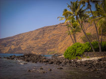 Kaiula Kona Hawaii King Kamehameha Home and Pacific Ocean Beach. Beautiful Daytime shot of lava rock in Kailua Kona Hawaii with Pacific Ocean in background King Stock Images
