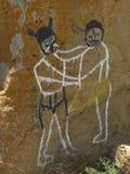 Kaivara, Karnataka, India - Januari 1, de Muurschildering van 2009 op granietrots die strijd tussen Bhima en demon Bakasura afsch Stock Fotografie