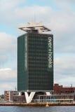Kaj i Amsterdam med moderna byggnader Royaltyfria Foton
