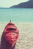 Kajak plástico en la playa Fotos de archivo libres de regalías