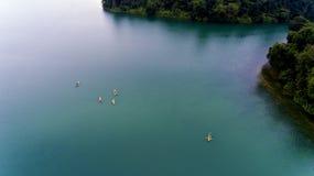 Kajaker på en blå sjö Royaltyfria Bilder
