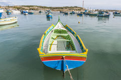 Kajjik Boat at Marsaxlokk harbor in Malta. Stock Photos