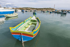 Kajjik Boat at Marsaxlokk harbor in Malta. Traditional Kajjik Boat at Marsaxlokk harbor, a fishing village located in the south-eastern part of Malta Stock Photography