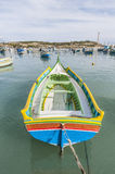 Kajjik Boat at Marsaxlokk harbor in Malta. Traditional Kajjik Boat at Marsaxlokk harbor, a fishing village located in the south-eastern part of Malta Royalty Free Stock Photo