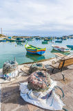 Kajjik Boat at Marsaxlokk harbor in Malta. Traditional Kajjik Boat at Marsaxlokk harbor, a fishing village located in the south-eastern part of Malta Royalty Free Stock Photography