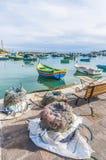 Kajjik Boat at Marsaxlokk harbor in Malta. Royalty Free Stock Photography