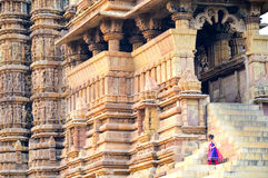 Kajuraho Temple Rajasthan, India. Kid playing at the Kajuraho Temples, famous for their erotic Kama Sutra sculptures Royalty Free Stock Images
