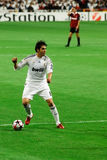 Kaka with the Ball. MADRID - OCT. 21, 2009: Real Madrid's Kaka looks for a teammate during their 2-3 loss against AC Milan in Champions League group stage action stock photos