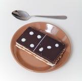 Kaka i form av den rektangulära dominobrickategelplattan Fotografering för Bildbyråer