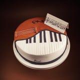 Kaka i Shape av pianot och violoncellen royaltyfri bild