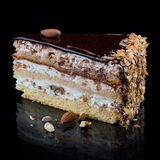 Kaka med tre typer av karamellmuttrar royaltyfria bilder