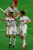 Kaka, Ronaldo and Benzema. MADRID - SEP. 30, 2009: Cristiano Ronaldo, Kaka, and Karim Benzema celebrate the first goal of Real Madrid's 3-0 victory over royalty free stock images