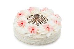 kaka som dekoreras med kräm- blommor Royaltyfri Foto