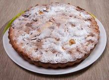 Kaka som strilas med pudrat socker Arkivbild