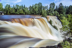 Kakabeka Falls in Thunder Bay. The steady and powerful flow of Kakabeka Falls in Thunder Bay Royalty Free Stock Photography