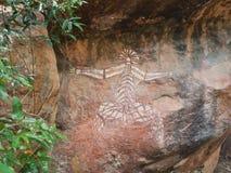 Kakadu, Austrália Ocidental, 06/10/2013, arte aborígene da rocha em Nourlangie, parque nacional de Kakadu, Territórios do Norte,  Imagens de Stock Royalty Free