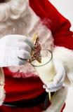 kakan mjölkar santa Royaltyfri Foto