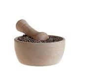 Kakaospitzen in der Stampfe auf Weiß Stockbild