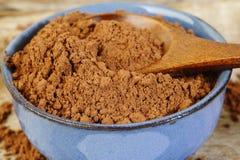 Kakaowy proszek w pucharze Obraz Royalty Free