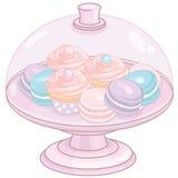 Kakaställning med muffin och makron Royaltyfri Fotografi