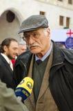 Kakhi Kavsadze. TBILISI, GEORGIA - NOVEMBER 17: Kakhi Kavsadze, honorary actor of Georgia gives the comments to the correspondent of the TV company Imedi, after Stock Image